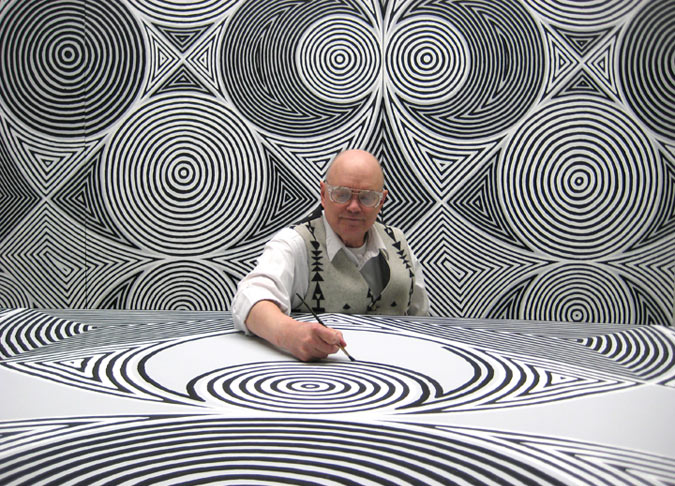 A man painting many geometrical shapes